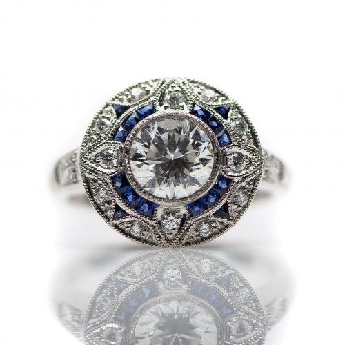 , Custom Diamond Engagement Ring set in a Platinum, Sapphire and Diamond Mounting