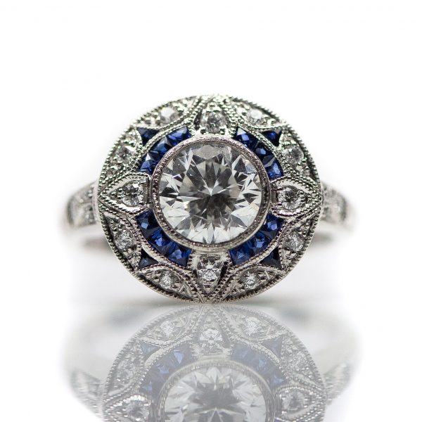 , Custom Diamond Engagement Ring set in a Platinum, Sapphire and Diamond Mounting