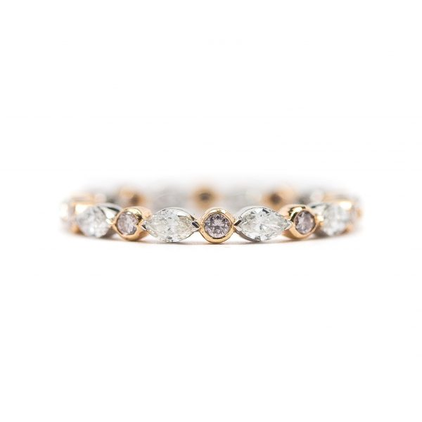 , Alternating round and marquise diamond eternity band; round pink diamonds are set in rose gold; white marquise diamonds are set in white gold