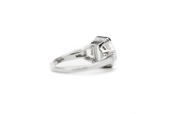 , Platinum Emerald Cut Diamond Engagement Ring with Trapezoid Side Stones