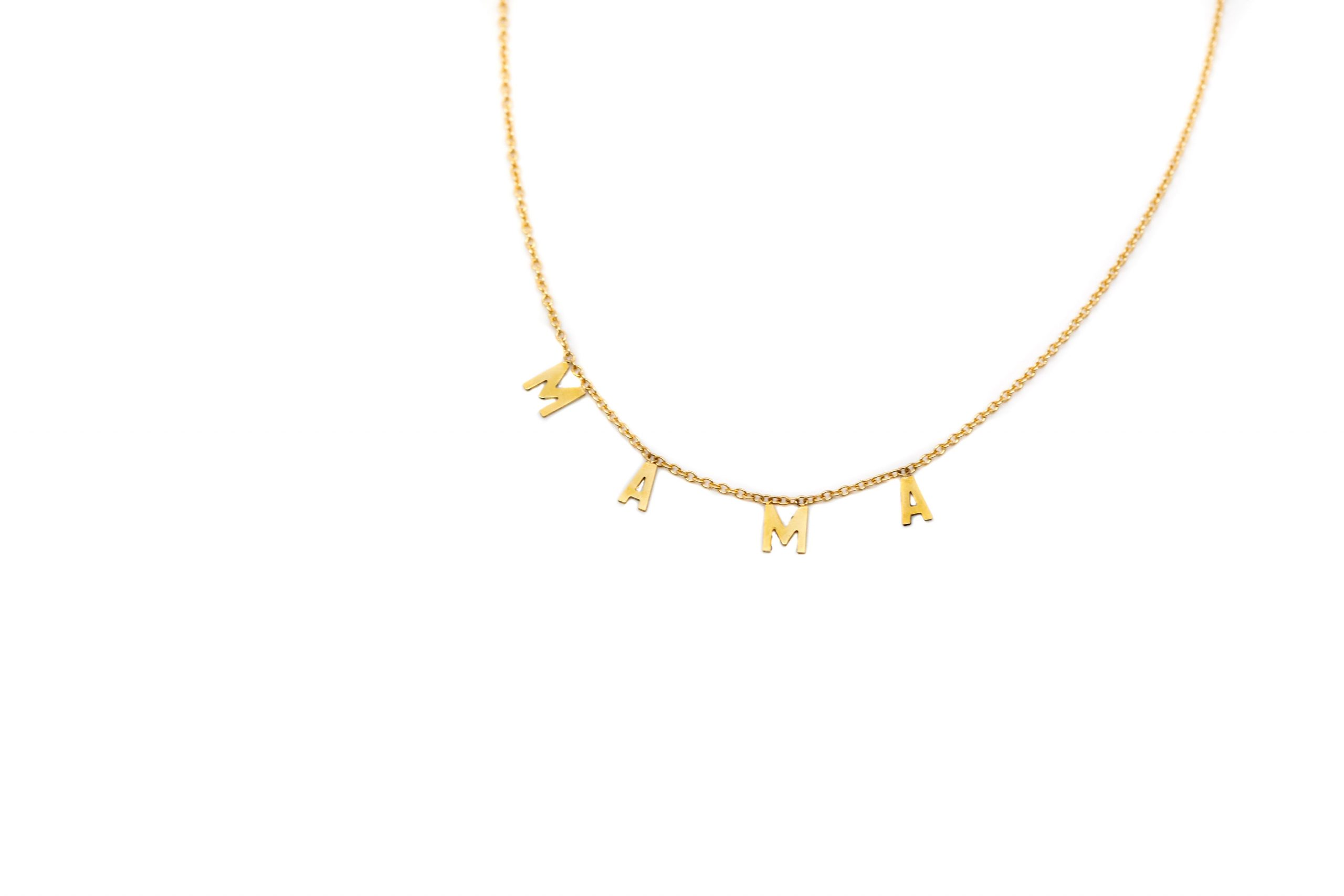 "gold necklace that reads ""Mama"""